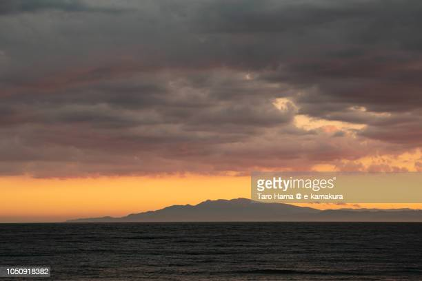 Red-colored sunset clouds on Sagami Bay and Mount Amagi in Japan