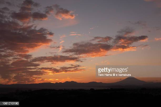 Red-colored sunset clouds on Sagami Bay and Mt. Fuji in Japan