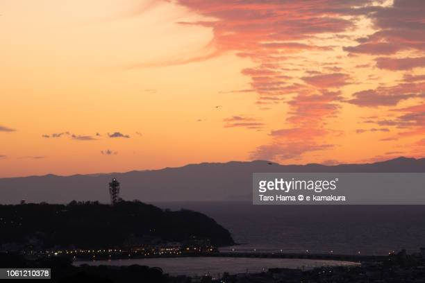 Red-colored sunset clouds on Sagami Bay, Enoshima Island and Izu Peninsula in Japan