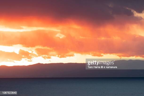 Red-colored sunset sunbeam on Izu Peninsula and Sagami Bay, Pacific Ocean in Japan