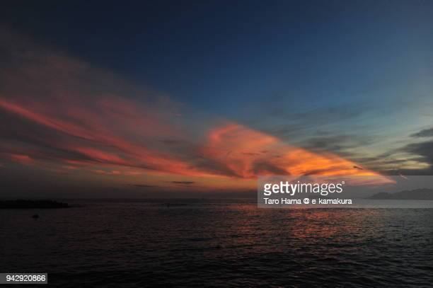red-colored sunset sunbeam on sagami bay, northern pacific ocean in japan - zushi kanagawa stock photos and pictures