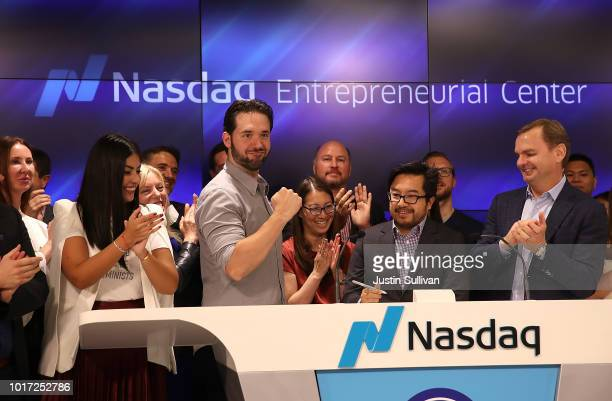 Reddit cofounder Alexis Ohanian pumps his fist as he rings the Nasdaq closing bell from the Nasdaq Entrepreneurial Center on August 15 2018 in San...