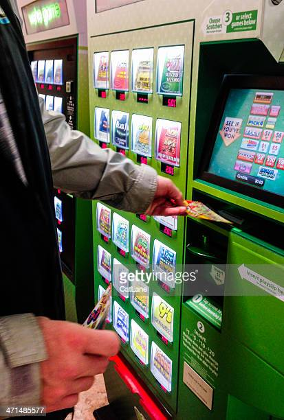redeeming a winning ticket at lottery vending machine - lottery ticket stock pictures, royalty-free photos & images