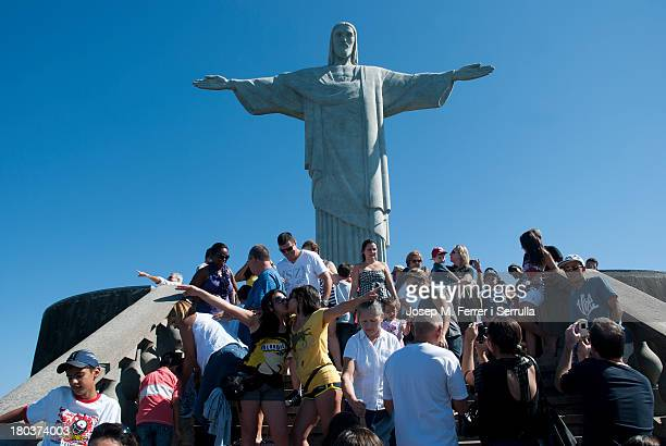 Redemptor Christ on the top of Corcovado mountain, embrace all people of the Rio de Janeiro city.