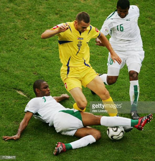 Redha Tukar of Saudi Arabia slides in to challenge Andriy Shevchenko of Ukraine for the ball during the FIFA World Cup Germany 2006 Group H match...