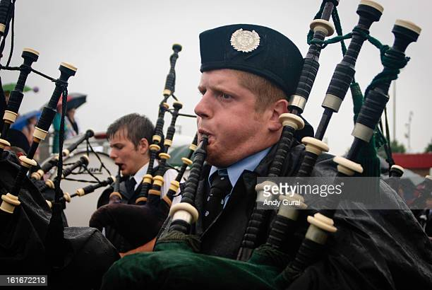CONTENT] Redhaired adult male bagpiper in rain gear underneath overcast skies This was taken in a parade at the Montreal Highland Games in 2008 RAW...