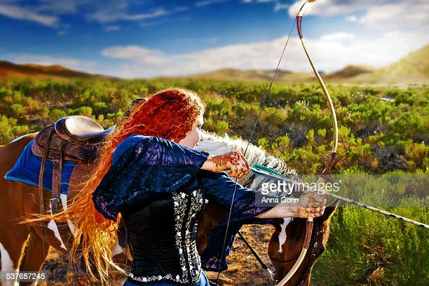 Redhaired archer in medieval dress with horse