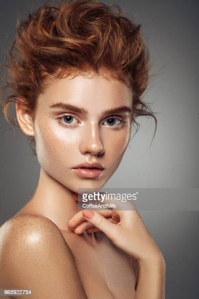red-haired girl with curls and fashionable make-up - lip balm stock pictures, royalty-free photos & images