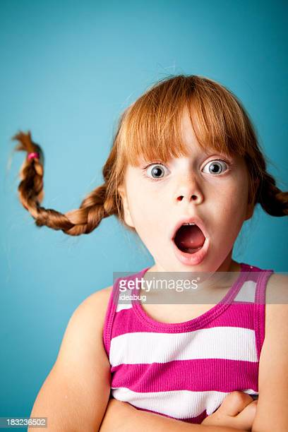Red-Haired Girl with Upward Braids and Look of Surprise