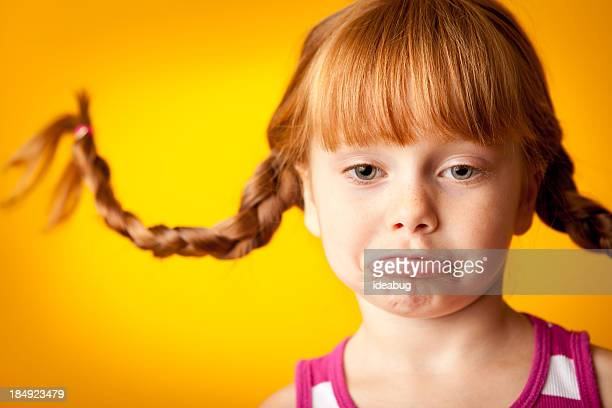 Red-Haired Girl with Upward Braids and Pouty Lip