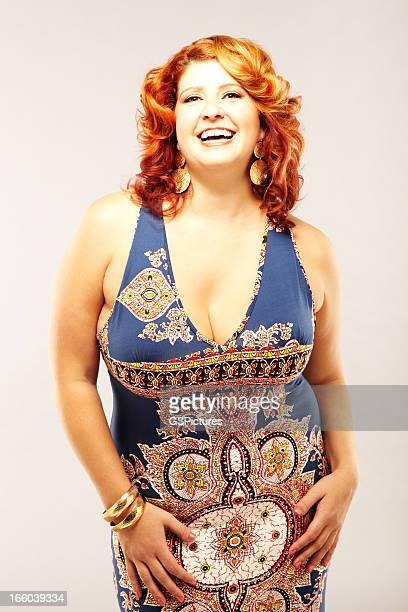Red-Haired Woman in Blue Patterned Dress smiling at camera