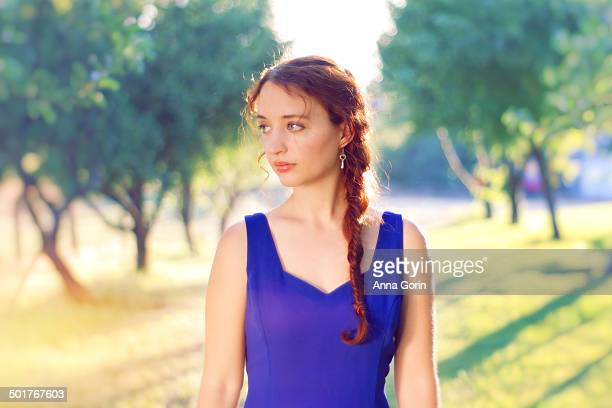 redhaired woman with braid in blue dress outdoors - neckline stock pictures, royalty-free photos & images