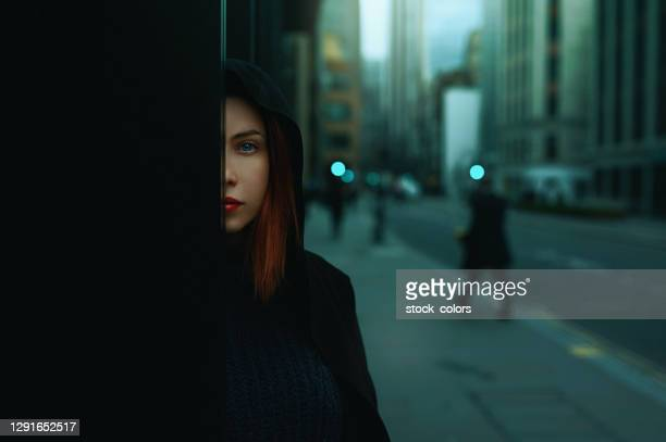 redhead acting suspicious in london - hiding stock pictures, royalty-free photos & images