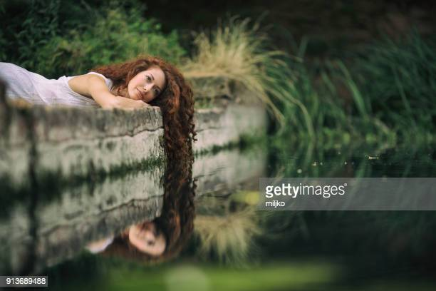 redhead beauty in nature by the lake - lake auburn stock photos and pictures