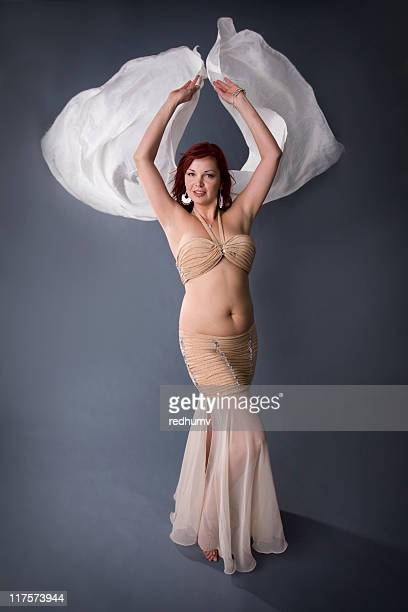redhead belly dancer - belly dancing stock photos and pictures