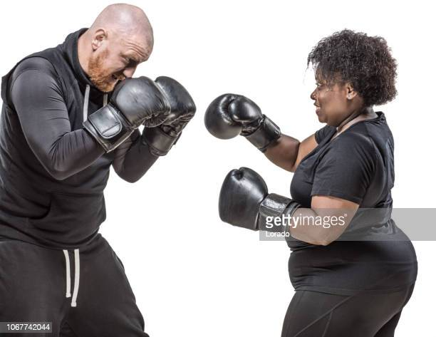 redhead boxing coach and overweight black woman training - mixed boxing stock photos and pictures