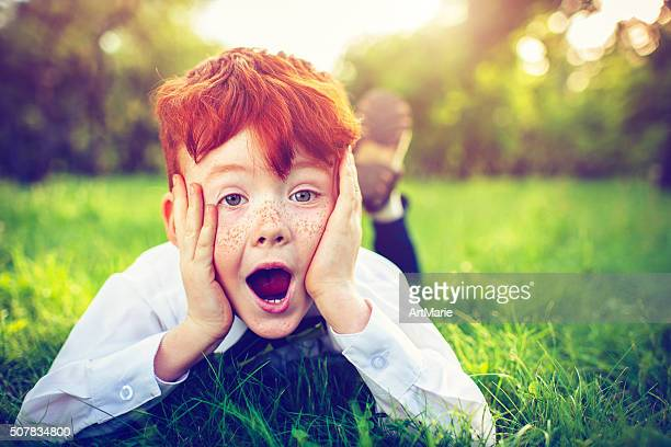 redhead boy outdoors - redhead stock pictures, royalty-free photos & images