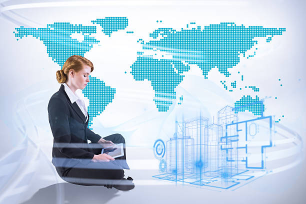 Composite image of redhead businesswoman using her tablet pc