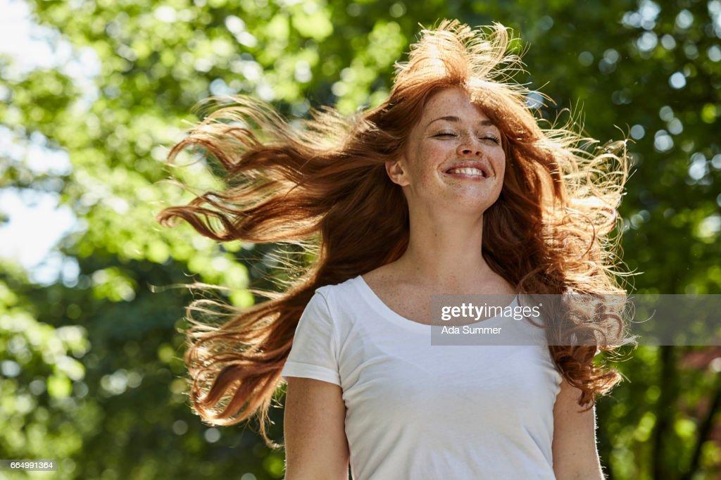redhead enjoying the first rays of sun : Stock Photo