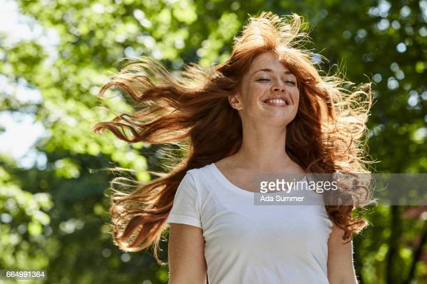 redhead enjoying the first rays of sun - redhead stock pictures, royalty-free photos & images