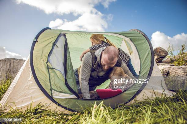 redhead father and blonde daughters on a sunny spring camping trip - northern europe stock pictures, royalty-free photos & images