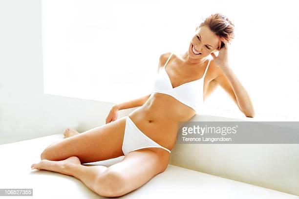 A redhead girl in white underwear.