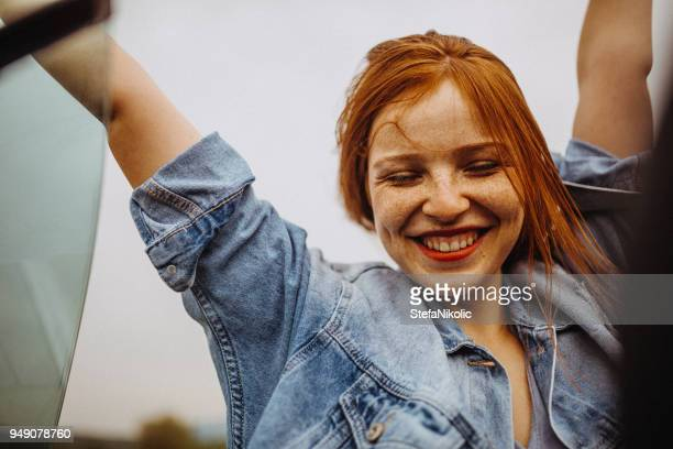 redhead having fun in the cabriolet outdoors - freckle stock pictures, royalty-free photos & images
