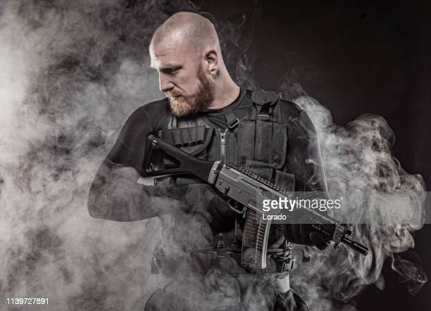 redhead military man - swat team stock photos and pictures