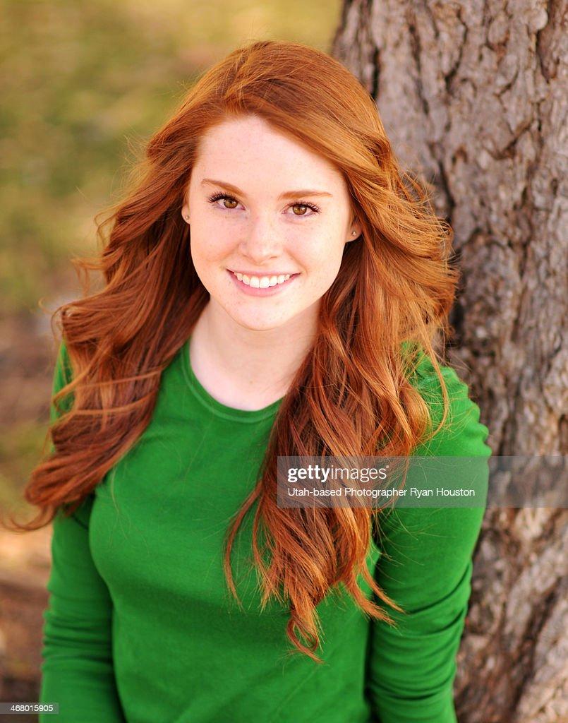 Redhead Model In Longsleeved Green Shirt Stock Photo