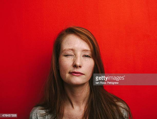 redhead on red 02 - red background stock pictures, royalty-free photos & images