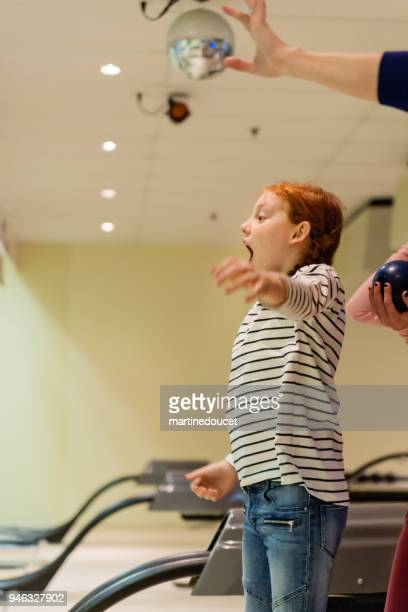 "redhead preteen girl playing bowling. - ""martine doucet"" or martinedoucet stock pictures, royalty-free photos & images"