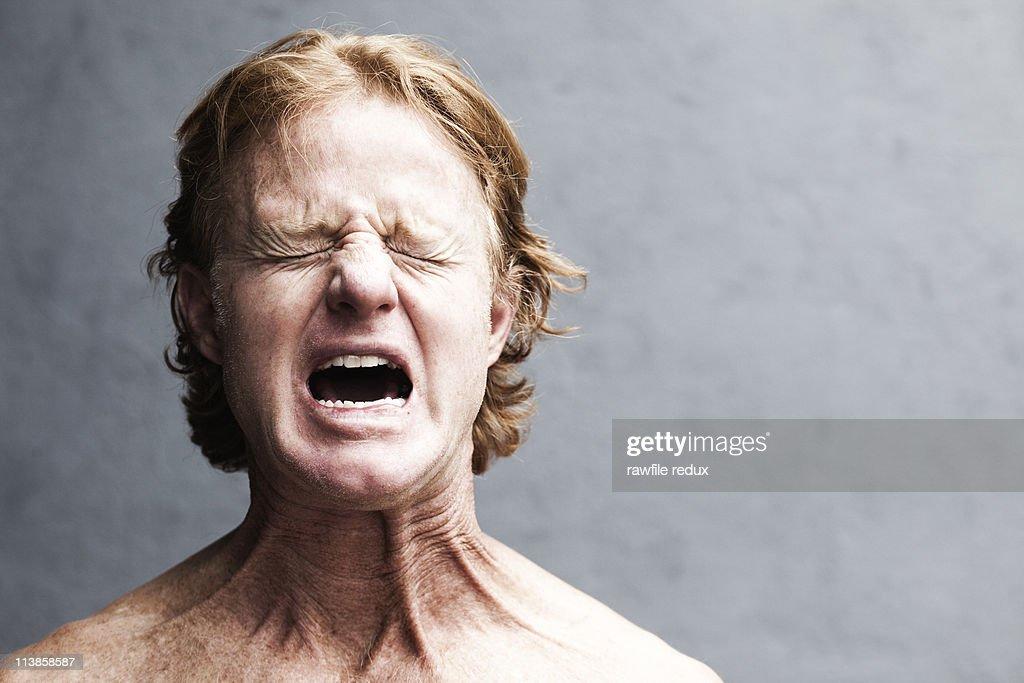 Redhead screaming : Stock Photo