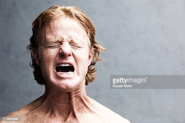 redhead screaming - pain stock pictures, royalty-free photos & images