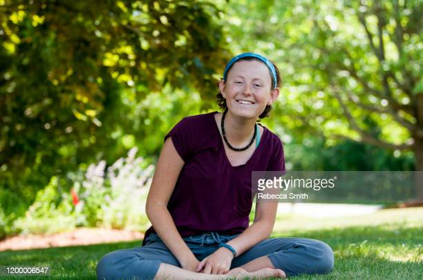 redhead sitting in grass - condition stock pictures, royalty-free photos & images