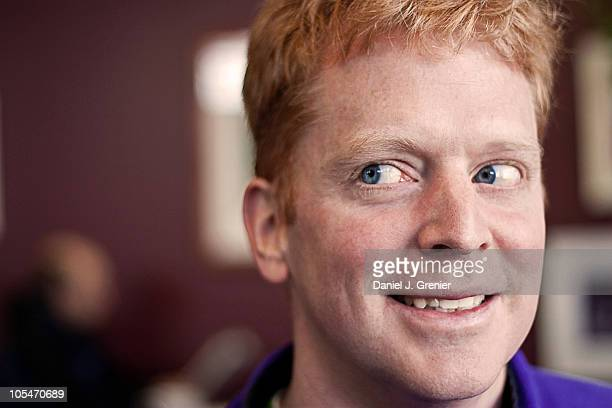 redhead smiling while looking right - smirking stock pictures, royalty-free photos & images
