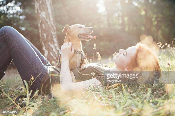 redhead teenage girl and her dog have fun outdoors