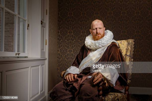 redhead traditional dutch man reading a book by candlelight - neck ruff stock pictures, royalty-free photos & images