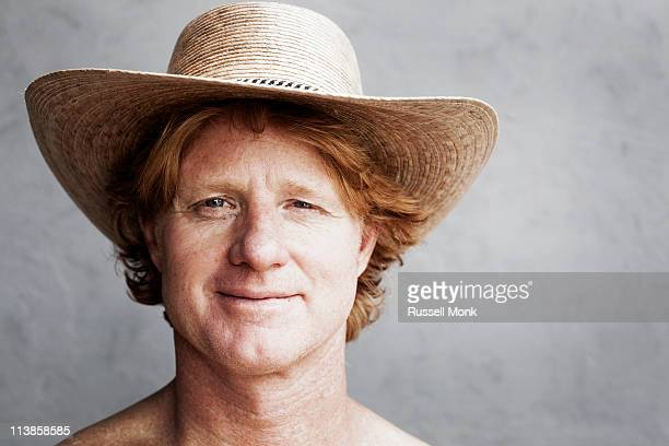 redhead wearing a hat - sun hat stock pictures, royalty-free photos & images