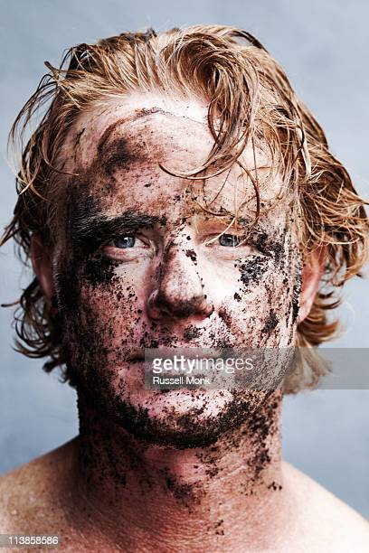 redhead with mud on his face - schmutzig stock-fotos und bilder