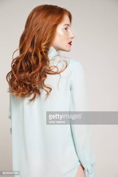 redhead woman in blue blouse - three quarter length stock pictures, royalty-free photos & images