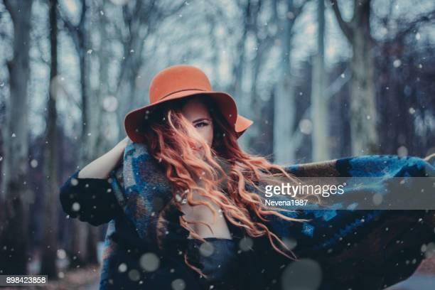 redhead woman in the wood,snow