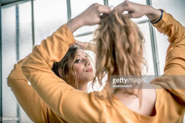 redhead woman looking at herself in mirror, paris, france - ponytail stock pictures, royalty-free photos & images