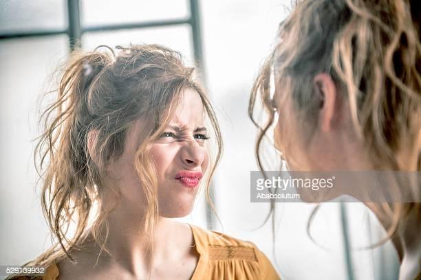 Redhead Woman Making Faces in mirror, Paris, France