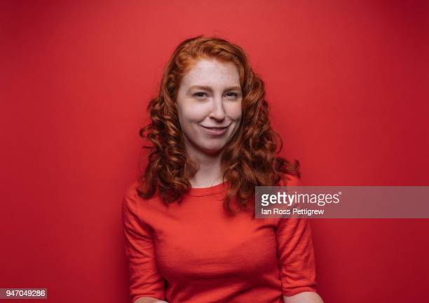 Redhead woman on red background