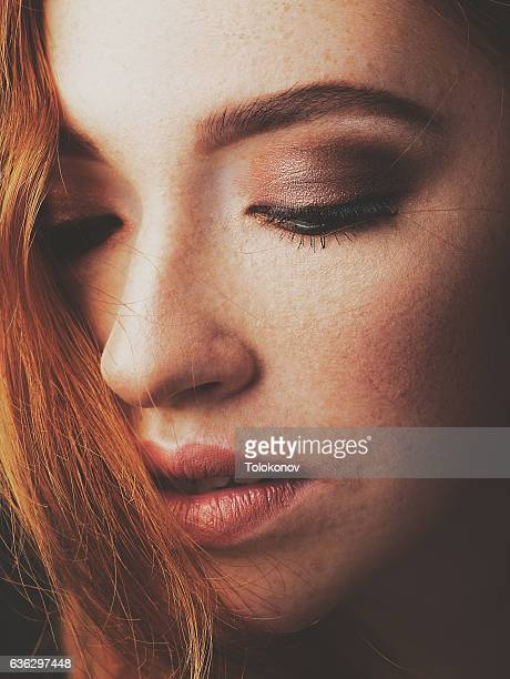 Redhead woman with funny freckles
