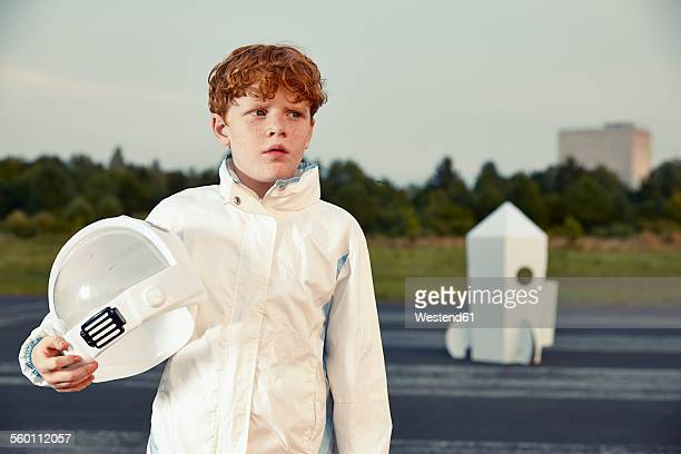 Redheaded boy dressed up as spaceman