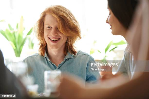 red-headed fellow on family brunch - cliqueimages stock pictures, royalty-free photos & images