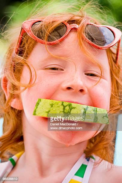 Redheaded Girl Enjoying Watermelon