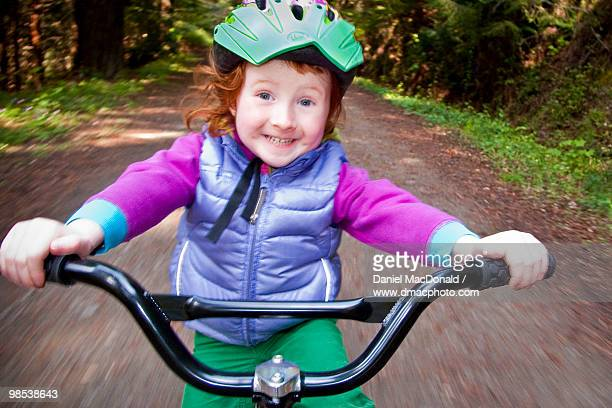 Redheaded Girl Riding a Trailer Bike