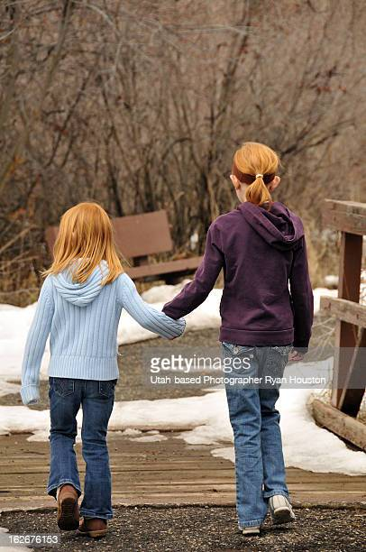 Redheaded Sisters Holding Hands at Park